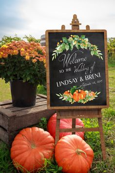 Welcome your guests with a beautiful Autumn sign. Designed with modern type, golden berries, colorful pumpkins and fall foliage. Personalized with your names and date.