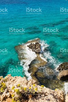 Stone cliff in a beautiful blue sea Cyprus royalty free stockfoto