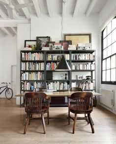 Modern Industrial Interior Design : Contemporary Home Interior Ideas : Extraordinary Industrial Loft In Barcelona With Charming Home Library Stunning Library Table Set Exciting Black Pendant Lamp Also Glossy Hardwooden Floor New York Loft, Industrial Dining, Modern Industrial, Industrial Shelves, Metal Shelving, Vintage Industrial, Design Living Room, Living Spaces, Loft Stil