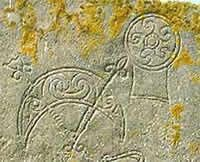 The Birsay Stone - The Crescent and V Rod and Mirror Case Carved into the stone's face are the fairly common Pictish symbols of a mirror and a crescent and V-rod.  Picture: Sigurd Towrie