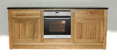 121 - Large cabinet with space for mounted oven in the centre.