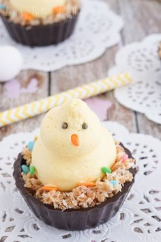 These Easter Chick Mousse Cups are so fun and easy to make! A simple vanilla creme mousse and toasted coconut tucked into a Belgian chocolate cup and decorated with sprinkles.