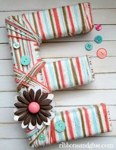 Make a DIY Yarn Wrapped Letter.  Easy yearn craft idea that can be made in any color or letter!