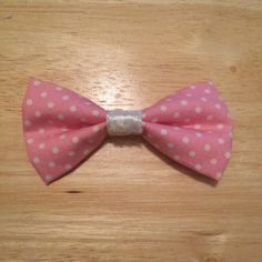Need a new hair accessory? What better way to accessorize than with a bow? And a pink polka dot one at that! - N