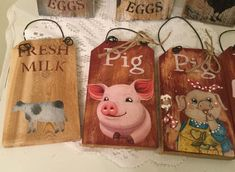 """""""Upcycled wood with Stenciled lettering in black and/or barn red or black and white cow, rooster or pig. Hangs from wire and measures lmost 3\"""" wide and 6\"""" long not including hanger. Ready to ship. Choose one. Listing is for one sign PLEASE LEAVE BRIEF DESCRIPTION OF WHICH SIGN YOU WANT Thanks for visiting and watch for more new listings. Listing is for 1 sign only, does not include any other items pictured."""" Farm Signs, Wood Signs, Rooster Kitchen, White Cow, Country Paintings, Fresh Milk, Red Barns, Black Spot, Country Decor"""