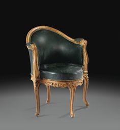 Fauteuil de bureau en hêtre d'époque Louis XV, estampillé E. MEUNIER, vers 1770 A LOUIS XV BEECHWOOD DESK ARMCHAIR, STAMPED E MEUNIER, CIRCA 1770 à décor de moulures fleuries, reposant sur des pieds cambrés, garniture de cuir vert Haut. 84 cm, larg. 60 cm Height 33 in; width 23 1/3 in