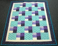Meredith Larson of Rehoboth, MA made and donated this quilt to Hopes & Dreams.  www.hopesanddreams.quiltersdreambatting.com.