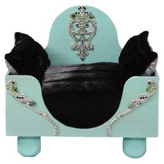 Tiffany blue pet bed with bejeweled detail and black upholstery.   Product: Pet bedConstruction Material: Wood an...