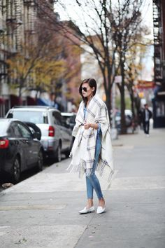 Enjoy the blanket coat trend and show off your figure by cinching the look in at the waist.