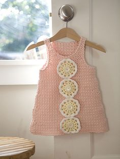 Pink Lemonade Dress, by Berroco Team   I love the use of doily motifs up the front!
