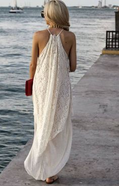 Feeling Free: The Spoonful of Style blogger is wearing a Free People lace maxi dress with a halter top. The dress has a rounded hemline.