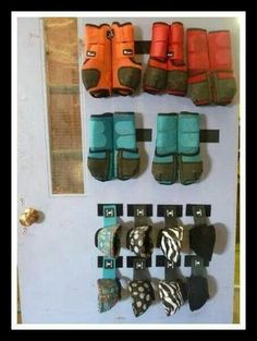 Good idea for hanging sports medicine boots and bell boots. Velcro tabs on the wall. For the horseman who has everything.