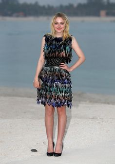 Dakota Fanning and her feathered Chanel couture dress. In Dubai #ChanelCruise2015