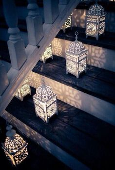 Use small LED candles inside lanterns to light the way to your outdoor living space.Moroccan lanterns lined on the stairs Moroccan Lanterns, Moroccan Decor, Moroccan Style, Moroccan Lighting, Moroccan Wedding, Turkish Decor, Turkish Style, Persian Wedding, Moroccan Design