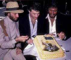 LR Maurice Gibb Andy Gibb and Barry Gibb attend the birthday party for Maurice Gibb on December 22 1982 at the Century Cafe in Century City California