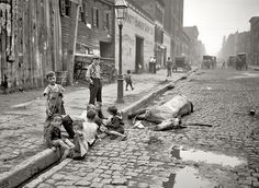 """""""children-and-dead-horse-street-in-new-york-c-1895"""" In New York at the end of the 19th century, it was not uncommon for dead animals to lie on the streets for weeks."""