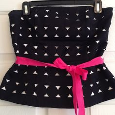 White House Black Market polka dot peplum bustier Gorgeous-looking appliqué polka dots on a pretty peplum with fuchsia grosgrain ribbon tie.. This is a high quality piece with boning for shape and support...Fabulous with a white, black or matching hot pink pencil or skinnies.. In excellent condition! White House Black Market Tops