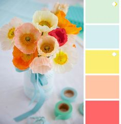 mint, light blue, lemon, peach, coral. emphasis on spectrum of yellows and mint.