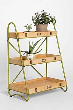 find some nesting trays and something to use on the sides and you've got yourself a plant stand!