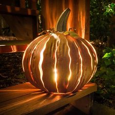 Features:  -Uniquely handcrafted.  -Illuminates patio areas and walk ways.  -Place a candle or light inside to illuminate.  -Powder coated inside and out of pumpkin is durable and when lit provides a