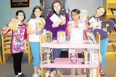 """The library at C. J. Hooker Middle School unveiled its new collection of """"pink books,"""" a genre of books for middle school girls. The books were acquired through a grant written by School Librarian Christine Banuls."""