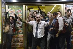 Spanish civilians try to escape police atacks in a cafe. The man in first plan is the owner who become famous after helping and defending some of the demonstrators. (Spain)  PIERRE-PHILIPPE MARCOU/AFP