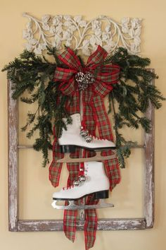 old window frame decorated for holiday.... Gonna do this for the front door instead of sticking my skates in a wreath like I usually do!:) I have just the frame to do it!!!