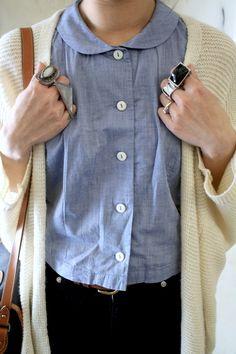 black pants, chambray top, white knit sweater