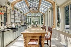 A glass conservatory kitchen. Greenhouse Kitchen, Conservatory Kitchen, Diy Greenhouse, Kitchen Sale, Rustic Kitchen, Kitchen Ideas, Kitchen Design, Funky Kitchen, Kitchen Decor
