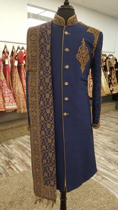 Navy blue pure dupion silk sherwani With chikankari sleeves Gold antique embroidery, and gold buttons Includes pajami, shoes and simple stole Banarsi stole not included Sherwani For Men Wedding, Wedding Dresses Men Indian, Groom Wedding Dress, Punjabi Wedding, Indian Weddings, Wedding Couples, Wedding Ideas, Wedding Suits, Wedding Details