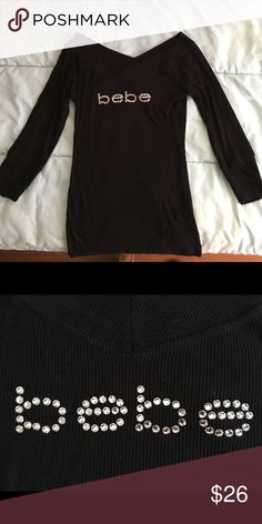 24ee2c2c67 Shop Women's bebe Black size M Tops at a discounted price at Poshmark.  V-neck, three quarter sleeve, never worn.