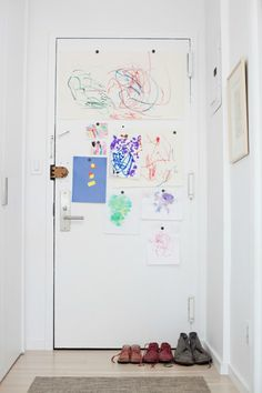 Sometimes Simple Is Best: Displaying Children's Artwork  -- Maybe paint back of a door with magnet paint?  But would have to find less swallowable magnets...