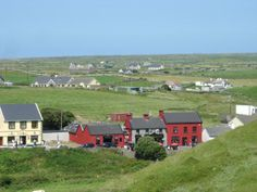 Daly's in Doolin, Ireland...it's the yellow building beyond the field behind the buildings