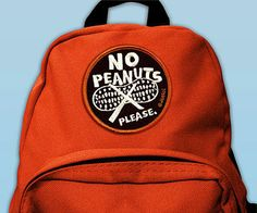"""If your child has a serious food allergy, there's a stylin', low-key alternative to the clunky medic alert bracelet he has to wear. Jeeto's allergy collection includes patches, shirts, and stickers with phrases like: """"No Peanuts Please"""" or """"Dairy Free"""" that you can plaster all over your child's backpack, jackets, or lunchbox to make sure teachers, babysitters, waitresses, and anyone who might give him food are aware of the no-nos on his list."""
