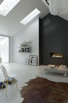 Sleek yet welcoming.  Love the white floors and black fireplace.  Love the clean lines.