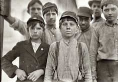 """January 1909. """"Doffers in Willingham Cotton Mill, Macon, Georgia. The three boys in front row have been in mill work for 4, 5 and 6 years respectively."""""""