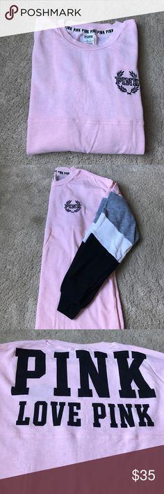Like new!!! Victoria Secret PINK sweatshirt Like new! This is a thinner Victoria Secret sweatshirt! Pink white gray black and white down the sleeve. Writing on the back! Worn once! PINK Victoria's Secret Tops Sweatshirts & Hoodies