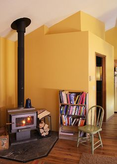 Woods stoves and yellow walls: nothing better than a house heated by a woodstove in my opinion