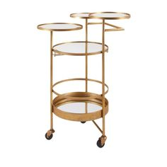 Imax Beth Kushnick Bar Cart 88917 Modern glass and metal bar cart features four serving tiers, an antiqued gold finish and three casters for easy mobility. Designed by Beth Kushnick. Metal Bar Cart, Gold Bar Cart, Modern Bar, Modern Glass, Modern Decor, Bar Furniture, Modern Furniture, Corner Furniture