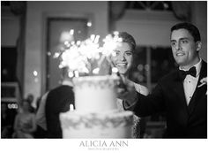 Bride and groom light their cake with sparklers - New Years eve wedding ideas
