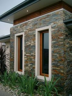 great contemporary exterior of home with stone work