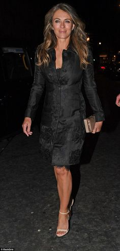 Sophisticated: Elizabeth Hurley looked glamorous in a black brocade coat as she enjoyed a night out at Scott's in Mayfair on Monday night
