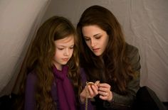Renesmee and Bella getting the locket - Renesmee is wearing a royal purple long sleeve shirt and a purple scarf