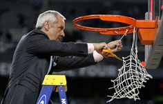 UNC Coach, Roy Williams, chopping off the last strand of nylon after the Tarheels' 2009 NCAA title run.