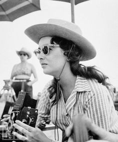 """Elizabeth Taylor on the set of the movie """"Giant"""" holding a camera"""