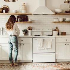 Love when a kitchen is all white and has numerous shelves.