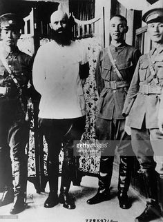 Photo shows Mikhail Borodin (second from left), Soviet advisor to the Contonese, and General Chiang Kai-Shek (third from left) at the last conference they held regarding the situation in China. Photo circa 1927.
