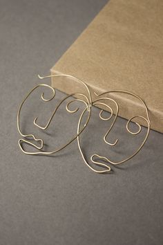 Face Hoops by TalAvishaiJewelry on Etsy https://www.etsy.com/listing/519412814/face-hoops #jewelrydesign