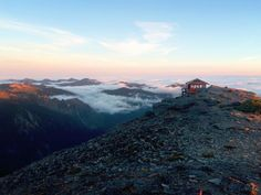 Rainier at Sunrise is a beautiful place to watch the sunrise. You are high above the clouds! Above The Clouds, Landscape Photographers, Washington State, Natural Beauty, Sunrise, Beautiful Places, Hiking, Adventure, Mountains
