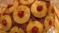 A baked spiral-sliced ham garnished with pineapple slices has a very retro feel. It's a recipe many of us are happy to revisit, especially around the holidays. Keeping the ham tightly wrapped in foil while it's in the oven ensures the meat will be succulent and juicy. Use canned pineapple slices packed in juice—fresh pineapple will not be as juicy and may dry out too quickly during cooking.
